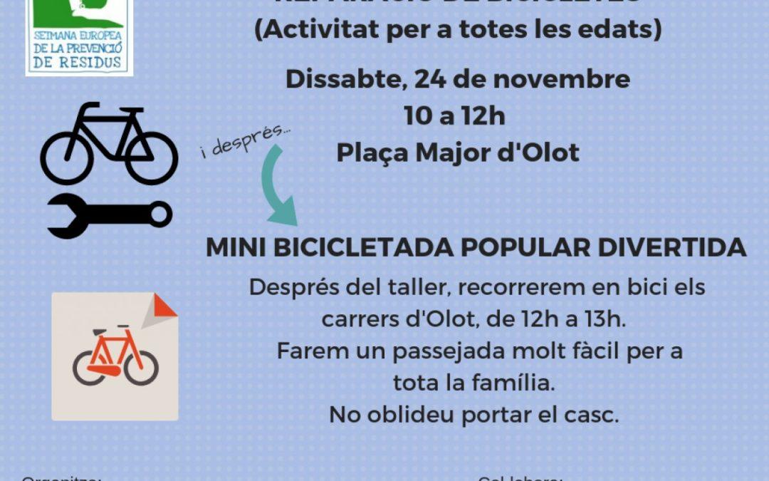 Taller de reparació de bicicletes a la plaça Major d'Olot